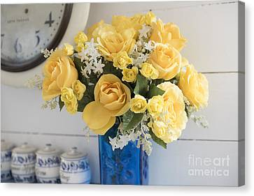 Yellow Flowers In A Blue Vase Canvas Print by Juli Scalzi