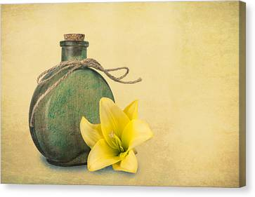 Yellow Lily And Green Bottle II Canvas Print by Tom Mc Nemar