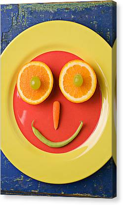 Yellow Plate With Food Face Canvas Print by Garry Gay