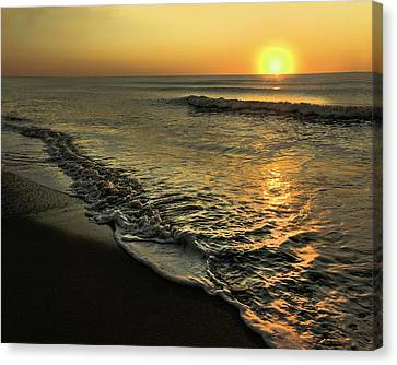 Yellow Sunset And Gentle Surf. Canvas Print by Gene Camarco
