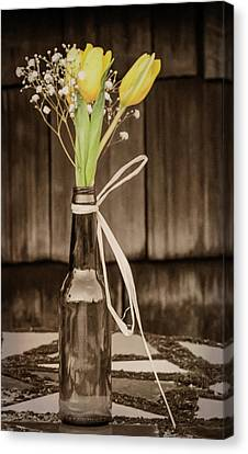 Canvas Print featuring the photograph Yellow Tulips In Glass Bottle Sepia by Terry DeLuco