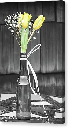 Canvas Print featuring the photograph Yellow Tulips In Glass Bottle by Terry DeLuco
