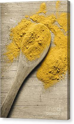 Yellow Turmeric Spice On Wooden Serving Spoon Canvas Print by Jorgo Photography - Wall Art Gallery