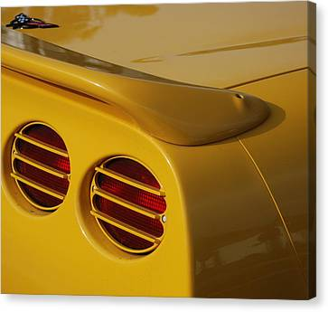 Yellow Vette Lights Canvas Print by Rob Hans