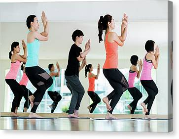 Fitness Instructor Canvas Print - Yoga Group In Class Room In Fitness Center by Anek Suwannaphoom