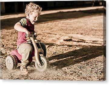 Break Fast Canvas Print - Young Boy Breaking At Fast Pace On Toy Bike by Jorgo Photography - Wall Art Gallery