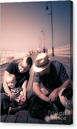 Young Couple And Baby Boy Sitting On The Boardwalk Canvas Print by Jorgo Photography - Wall Art Gallery