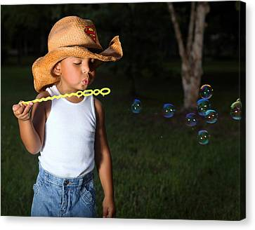 Young Cowboy Blowing Bubbles Canvas Print
