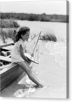 Young Girl At Seashore Holding Canvas Print by H. Armstrong Roberts/ClassicStock