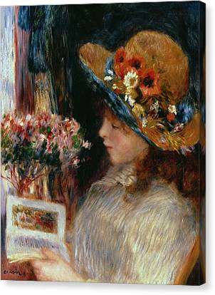 Young Girl Reading Canvas Print by Pierre Auguste Renoir
