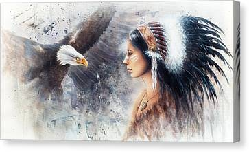 Young Indian Woman Wearing A Gorgeous Feather Headdress. With An Image  Eagle Spirits Canvas Print