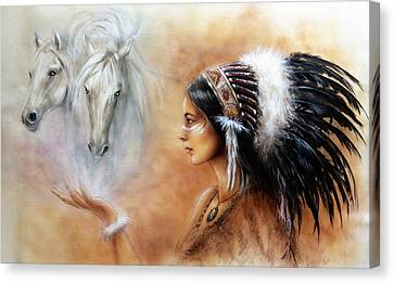 Young Indian Woman Wearing A Gorgeous Feather Headdress With An Image Of Two White Horse Canvas Print by Jozef Klopacka