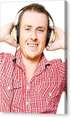 Youthful Canvas Print - Young Man Listening To Music Through Earphones by Jorgo Photography - Wall Art Gallery
