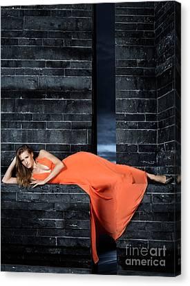 Young Woman In Long Orange Dress Canvas Print by Oleksiy Maksymenko