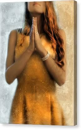 Young Woman Praying Canvas Print by Jill Battaglia