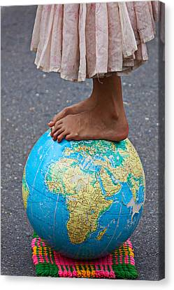 Young Woman Standing On Globe Canvas Print by Garry Gay