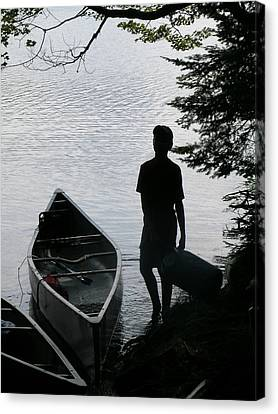 Youth With Canoe Canvas Print by Jim DeLillo