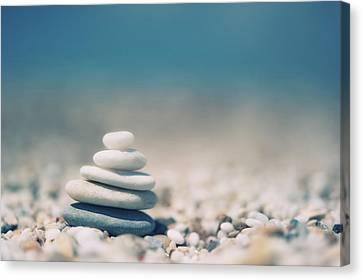 Zen Balanced Pebbles At Beach Canvas Print by Alexandre Fundone
