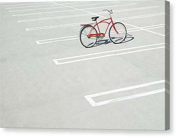 Bike In Empty Parking Lot Canvas Print by Peter Starman