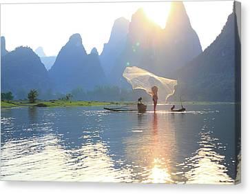 Fishing On The Li River Canvas Print by Bihaibo