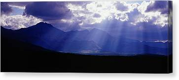 Panoramic Beaming Light In Waterton Canvas Print by Jason v