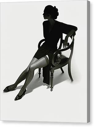 Silhouetted Woman On Chair Canvas Print by Tim Platt