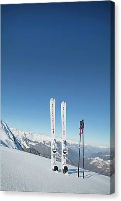 Skis And Ski Poles Stuck In The Snow Canvas Print