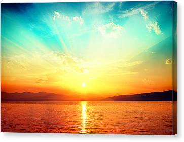 Sunset Over Water Canvas Print by Alexsava
