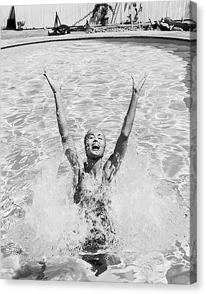 Woman Having Fun In Swimming Pool Canvas Print by Tom Kelley Archive