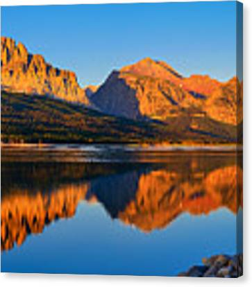 First Light Across Lake Sherburne Canvas Print by Greg Norrell