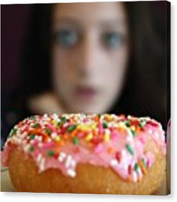 Girl With Doughnut Canvas Print