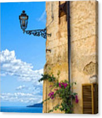 House With Bougainvillea Street Lamp And Distant Sea Canvas Print by Silvia Ganora