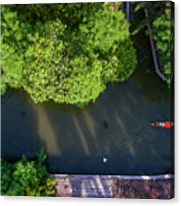 Monk Rowing Boat Along Floating Market Aerial View Canvas Print by Pradeep Raja PRINTS