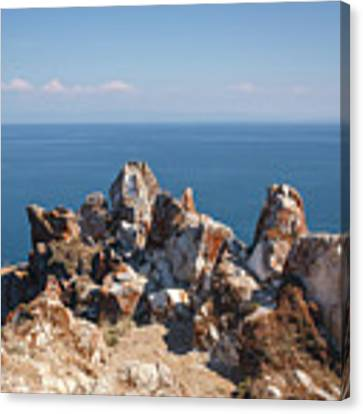 Red Rocks On Blue Sky And Water Background Canvas Print by Sergey Taran