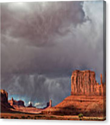 Storm Over Monument Valley Canvas Print by Wesley Aston