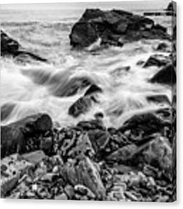 Waves Against A Rocky Shore In Bw Canvas Print by Doug Camara