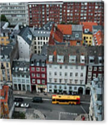 Yellow Bus In Copenhagen Denmark Canvas Print by Mary Lee Dereske