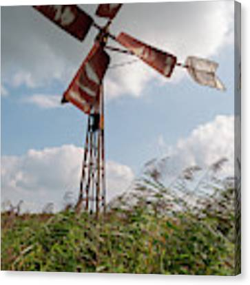 Old Rusty Windmill. Canvas Print by Anjo Ten Kate