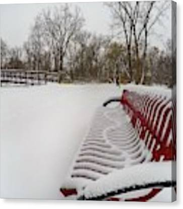 Red Bench In The Snow G0903432 Canvas Print by Michael Thomas
