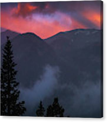 Sunset Storms Over The Rockies Canvas Print by John De Bord