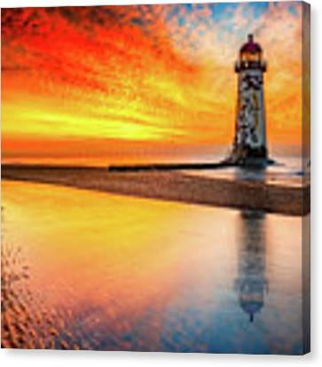 Welsh Lighthouse Sunset Canvas Print by Adrian Evans