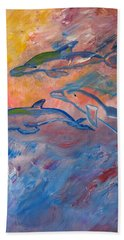 Hand Towel featuring the painting  Soaring Dolphins by Meryl Goudey