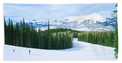 Tourists Skiing On A Snow Covered Bath Towel
