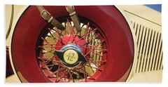 Bath Towel featuring the photograph 1933 Auburn 12-161a Custom Speedster Spare Tire Emblem by Jill Reger