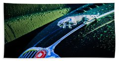 Bath Towel featuring the photograph 1960 Jaguar Xk 150s Fhc Hood Ornament -0441c by Jill Reger