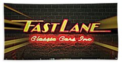 Fast Lane In Lights Bath Towel by Kelly Awad