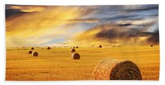 Golden Sunset Over Farm Field With Hay Bales Bath Towel by Elena Elisseeva