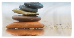 Stack Of Beach Stones On Sand Bath Towel