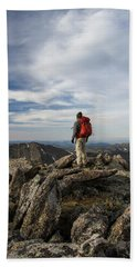A Backpacker Stands Atop A Dramatic Hand Towel