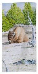 A Buffalo Sits In Yellowstone Bath Towel